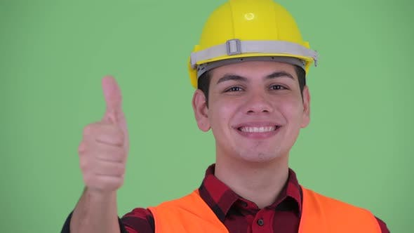 Thumbnail for Face of Happy Young Multi Ethnic Man Construction Worker Giving Thumbs Up