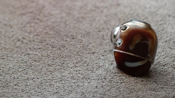 Mug of coffee spilling on carpet in slow motion; shot on Phantom Flex 4K at 1000 fps
