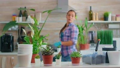 Florist Woman Checking Plants