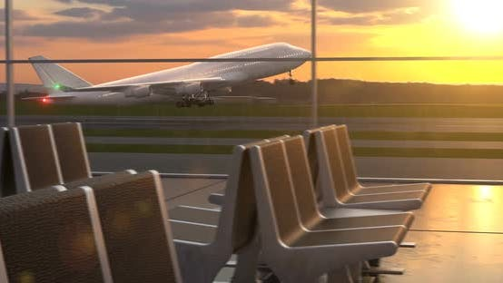 Thumbnail for Airplane Taking Off Against Scenic Sunset Seen Through Departure Lounge Windows