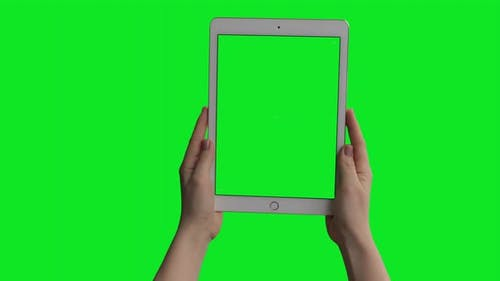 iPad Air tablet computer mockup with green screen isolated on chroma key background.