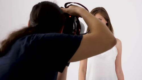 Backstage of a Photoshoot with Photographer and a Model