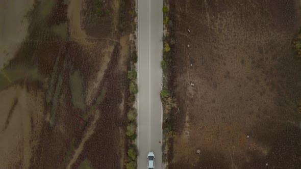 Thumbnail for Aerial view of a car driving on asphalt road in Greece.