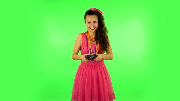 Girl Playing a Video Game Using a Wireless Controller. Green Screen
