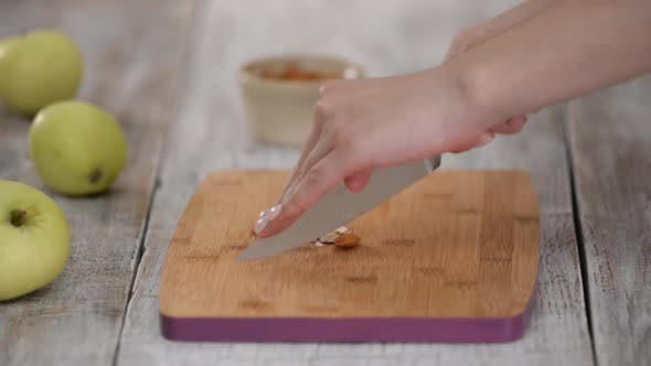 Thumbnail for Chef Cutting Almonds with a Knife