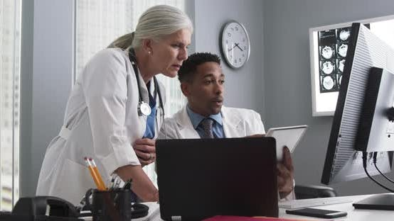 Thumbnail for Two medical doctors working inside office using technology