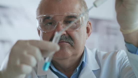 Thumbnail for Technician Carefully Drips the Solution From the Pipette Into Glass Tubes for DNA Analysis. Doctor