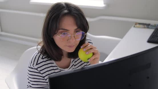 Thumbnail for Happy millennial professional designer portrait in eyeglasses with apple