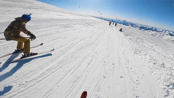 Skiers Riding on Snowy Slope