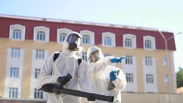 Professional Disinfectors Looking for Potentially Dangerous Places