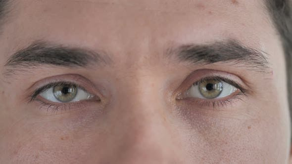 Thumbnail for Close Up of Blinking Eyes of Young Man Looking at Camera
