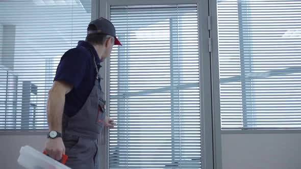 Repairman Checks the Office and Leaves