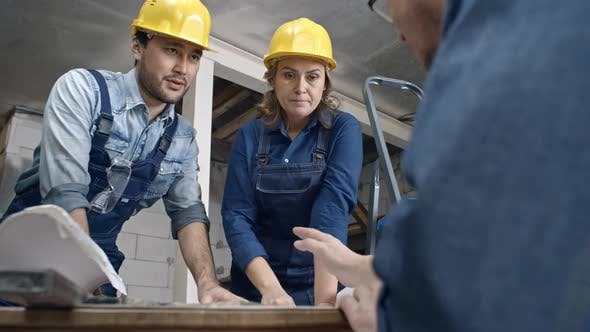 Thumbnail for Construction Workers Discussing Documents