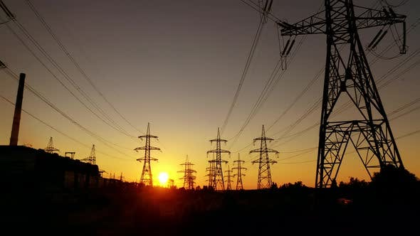 Electric towers against the orange sunset