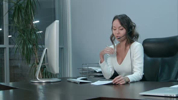 Thumbnail for Young Beautiful Asian Businesswoman with Headset in Office