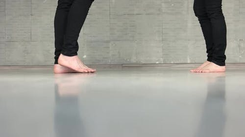 Bare Foot of Young Couple in Love on the Floor
