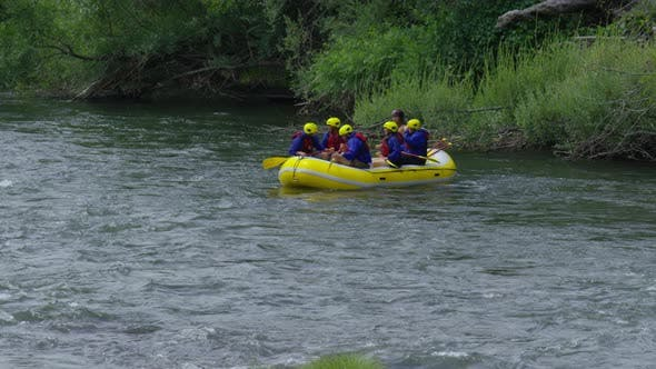 Thumbnail for Group of people white water rafting celebrate