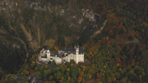 Thumbnail for AERIAL: View of Neuschwanstein Castle in Forest,Mountains, Summer, Foggy, Colourful