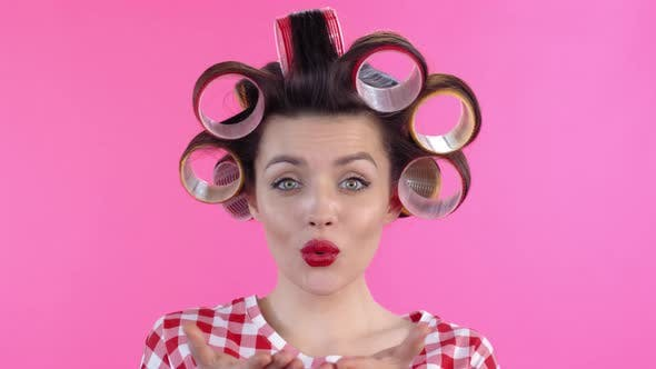 Thumbnail for Woman in Hair Rollers Blowing Kiss
