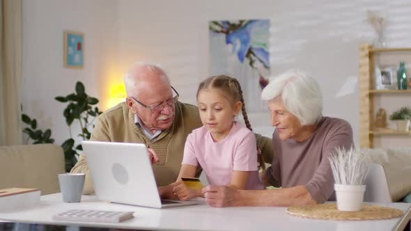 Thumbnail for Granddaughter Teaching Grandparents to Shop Online