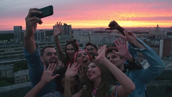Thumbnail for Young Friends Taking Selfie against Cityscape