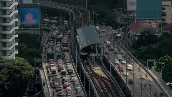 Thumbnail for Time Lapse Shot of Multi-level Traffic Road, Railway and Train Station. Bangkok, Thailand