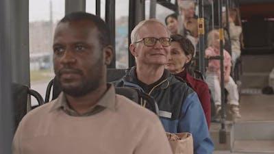 Happy Older Man Riding Public Bus