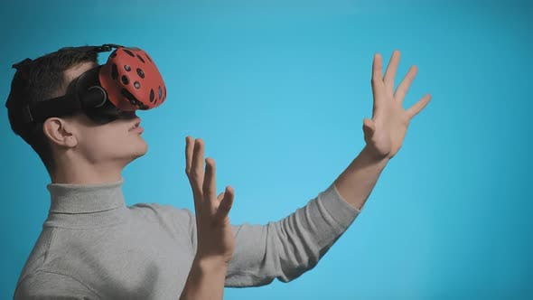 Thumbnail for Man Points To Virtual Screen Wearing Device Googles