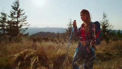 Serious Girl Trekking in Mountains at Vacation