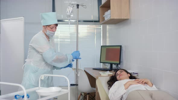 Thumbnail for Nurse Preparing Female Patient for IV Therapy in Clinic