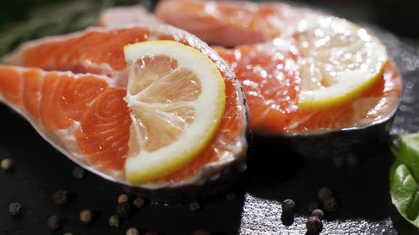 Cover Image for Close Up Rotation View of Seasoning Process of Salmon's Fillet.