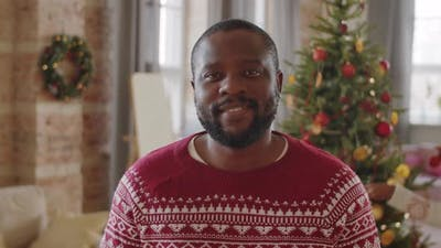 Portrait of Positive Black Man at Home on Christmas Day