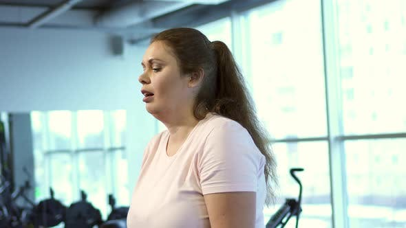 Thumbnail for Fat Woman Works Out in Gym To Lose Weight