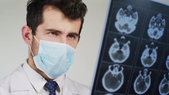 Thumbnail for Close up of a doctor looking at X-rays