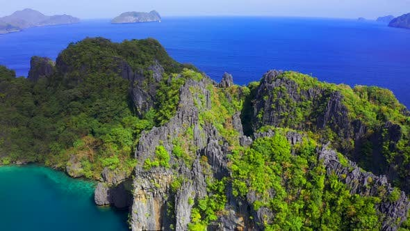 Thumbnail for Green Trees Covered Mountains with Lagoon on Background Blue Sea in El Nido, Palawan, Philippines