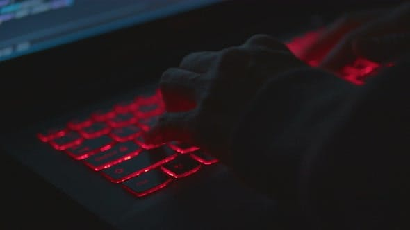 Thumbnail for Hacker Working At Night