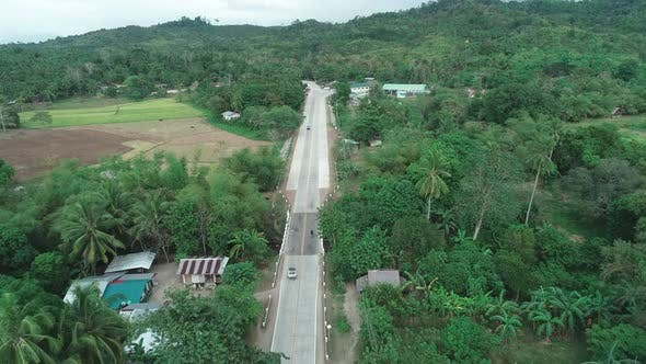 Thumbnail for Aerial Drone Shot of Concrete Road in a Small Farming Community, Aerial View of Countryside Road