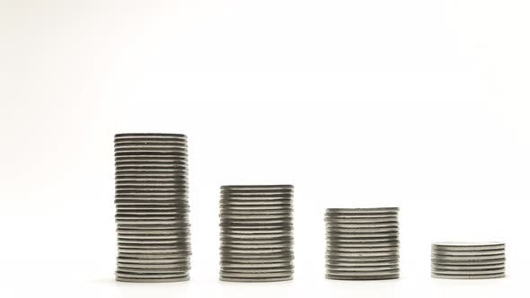 Silver Coins on Stacks Are Decrease and Increase on White Background Stop Motion Animation