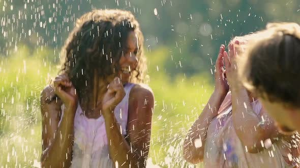 Thumbnail for Two Laughing Young Women Get Splashed With Water at Color Festival, Slow Motion