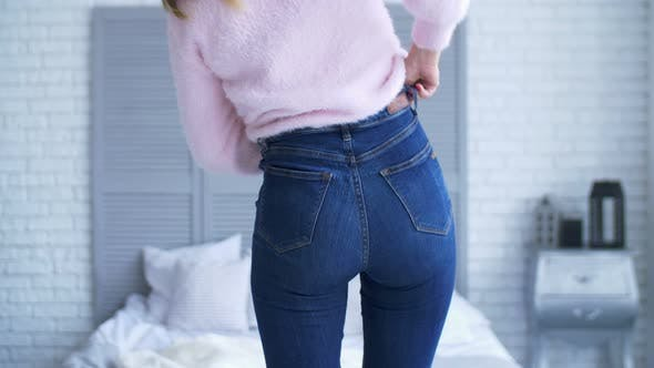 Thumbnail for Woman Fitting in Tight Jeans in Bedroom