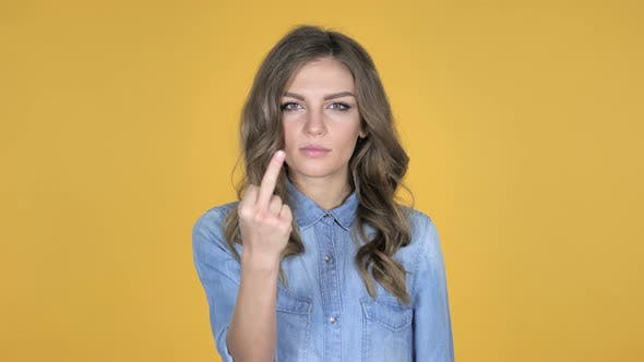Thumbnail for Young Girl Showing Middle Finger Isolated on Yellow Background