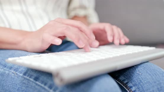 Thumbnail for Woman typing on laptop computer