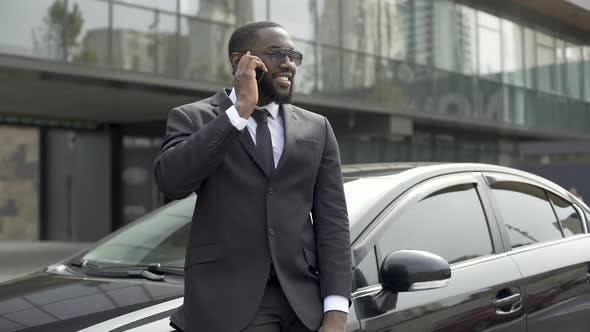 Thumbnail for Successful Man in Expensive Suit Communicating on Phone, Standing Near His Car