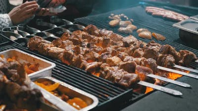 Meat Grilled on Skewers on the Grill on the Street Market