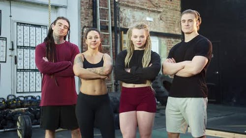 Four Athletes are Posing for the Camera