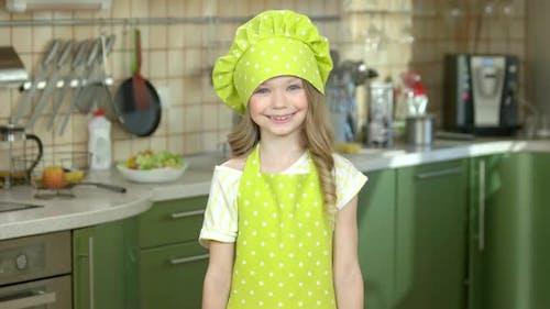Happy Girl with Kitchen Utensils