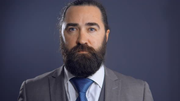 Thumbnail for Mature Beardy Businessman in Grey Suit