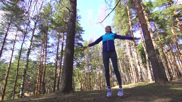 Sports Girl Warmup in a Sunny Forest