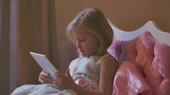 Blond Caucasian Girl Lying Aside Tablet and Going To Bed