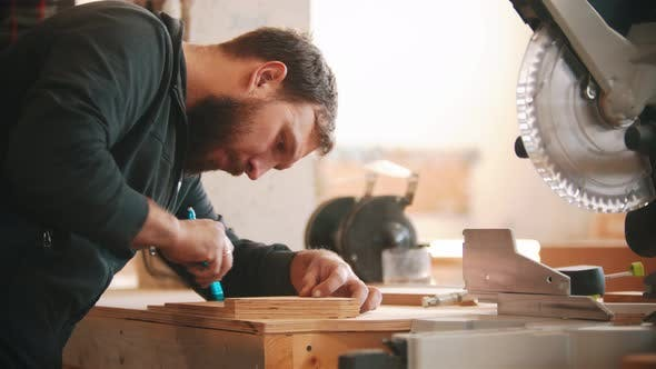 Thumbnail for Carpentry Working - Bearded Man Making Marks on the Plywood